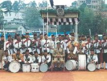 Group Photo of the C.T.I Pipe Band with Shri S.C. Reade, Commandant, C.T.I on the Annual Day Parade Dec 2000 at the C.T.I Parade Ground.